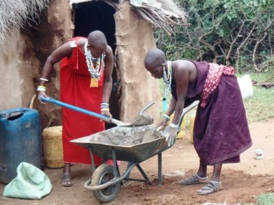 Maasai Stoves & Solar Installation Team preparing mortar to install smoke-removing chimney stove